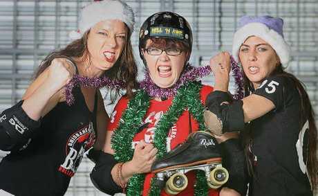 HARD HITTERS: Under Ceej (Carla Paterson), Hell 'n' Awe (Eleanor Swiatek) and Mace (Rachel Powers) prepare for Saturday's Christmas-themed roller derby bout.