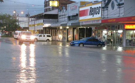 Businesses along McDowall St, Roma were flooded after about 70mm of rain hit the town in less than an hour.