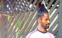 Suthakaran Sivagnanathurai trains to set a Guinness World Record for hanging by his hair.