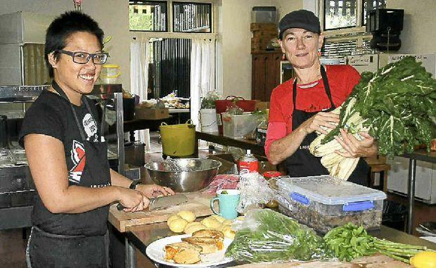 COOKING FOR CHRISTMAS: Rhonda Khong with volunteer Vikki Fraser. Photo Gary Chigwidden