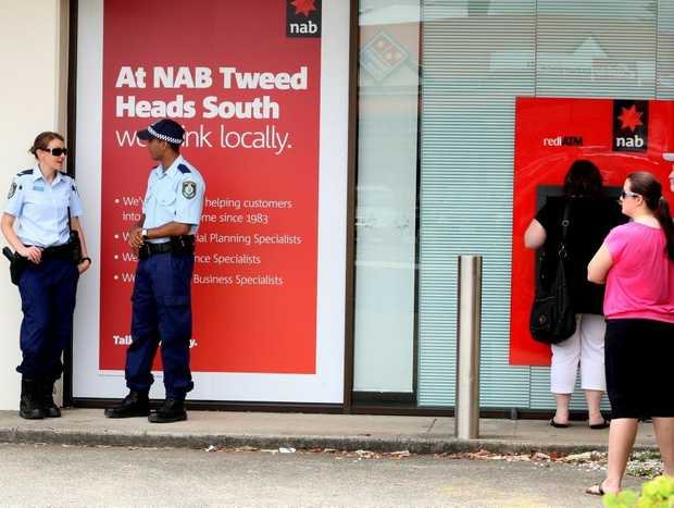 Police investigate the robbery of a National Australia Bank in Tweed Heads South last December. A man has been refused bail over the incident.