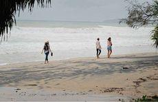 Tourists on Rainbow Beach.