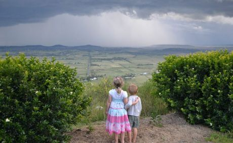Chelsea and Charlie Rolph watch on from Panoramic Drive, Hodgson Vale as storm clouds approach from the south.