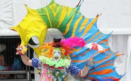 Toot the Magical Clown jumps for joy at Woodford Folk Festival.