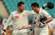 Michael Clarke of Australia hugs team mate Michael Hussey at the close of play during day two of the Second Test Match between Australia and India.