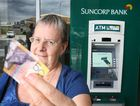 Maria Smith had a Suncorp ATM dish her a $50 note that was cut in half.