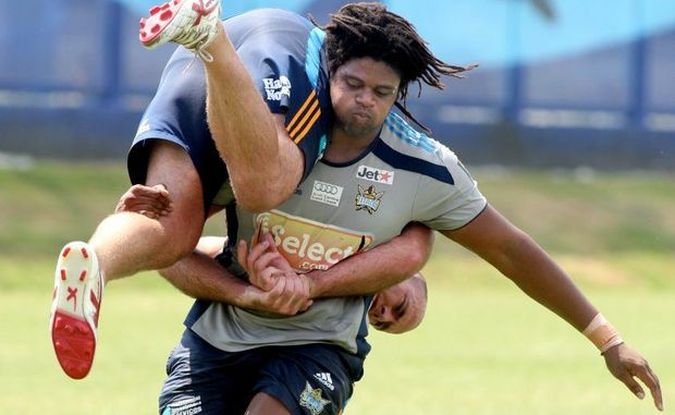 Star recruit, Jamal Idris, pictured here giving a lift to Matt White at training, makes his debut for the Titans in a trial against Brisbane Broncos on Saturday night