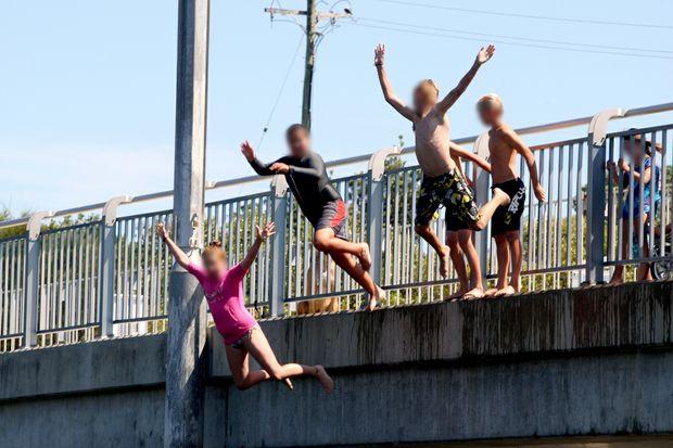 Children jump from Cudgen Creek Bridge, Kingscliff.