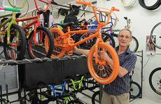 Dave Phillips, of Mary St's Pedal Power Plus bicycle shop, turned a flood into a refurbishment.