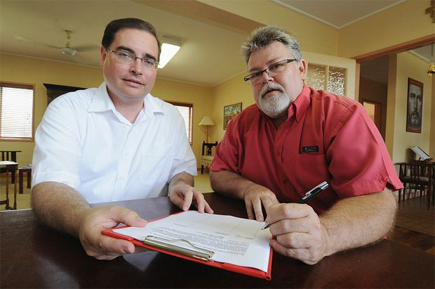 """Chris Foley signs Fr Paul Kelly's petition to overturn the use of """"gay panic"""" as a partial defence in murder cases."""