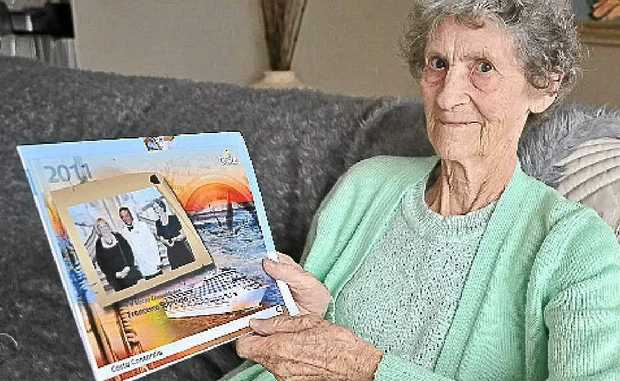 Margaret Hughes (right) recently holidayed on the cruise ship that sank off the coast of Italy. She even had her photo taken with the ship's captain.