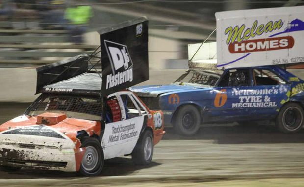 DJ Lennon leads Jeff Ohl into a corner in a Super Stockers heat at Rockhampton Speedway during a recent meeting at the Showgrounds.