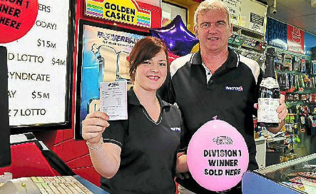 Noosa Village News owner Greg Hales celebrates with his daughter Rachel after selling a Division 1 lotto ticket.