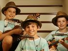 3 Busketeers pose for a photograph after being nominated for an Australia Day Award for their busking. (L to R) Hudson Lucas, Jackson Lucas and Bradley Entermann.