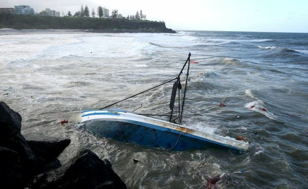 A fishing trawler of the rocks at Duranbah beach. Photo: John Gass / Daily News