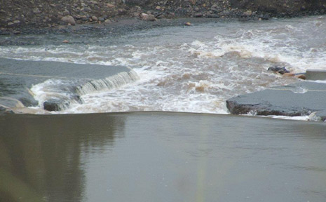 FLOW WOES: Bauers Crossing at Mt Sylvia was damaged by flash flooding in the area has cut off many residents from town.