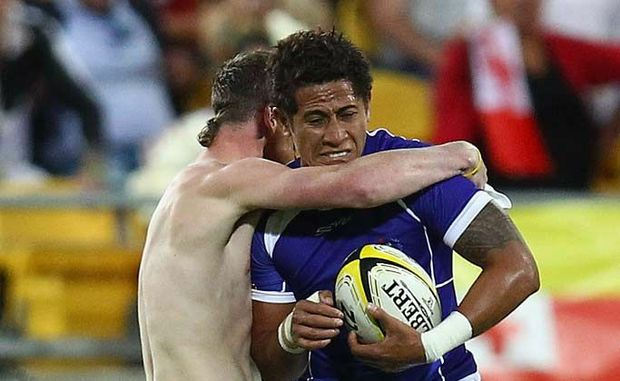 A near-naked 19-year-old earned an assault charge and a two-year ban from the stadium for this tackle on Alatasi Tupou.