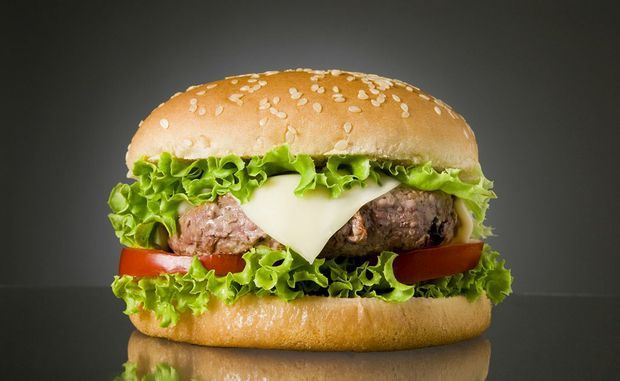 Celebrity chef Heston Blumenthal is the favourite to cook the $A250,000 hamburger made from stem cells.