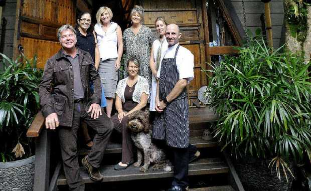 Happy to hear that Gaia Retreat and Spa has featured in heavily in the top Trip Advisor awards are staff (from left) co-owner Gregg Cave, accounts Jody Peachey, manager Leanne Schoen, front of house Karen Leggett, reservations Kylie Tuck, head chef Dan Trewartha, and seated with Gio is spa manager Naomi Quarrell.