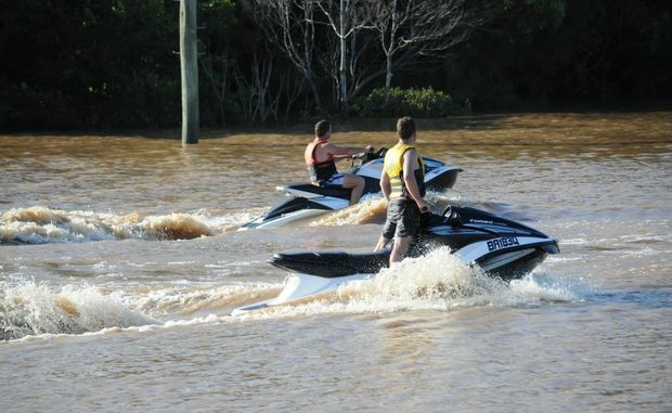 Jet skis in the flooded Mary River around the touch fields.