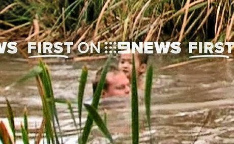 Nine Network cameraman and former Rockhampton man Glenn Edwards rescues missing Vietnamese boy Ryan Pham from a swollen Kororoit Creek after heavy rainfall yesterday.