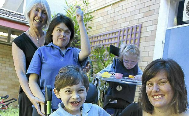Ashton Hayes, 5, and mum Angela (front) with (rear l-r) Wilson Park School principal Helen Rae and students Shannan Nurse, 17, and Hayley Cameron, 7.