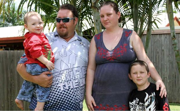 PROTEST: Simon Collie, with his fiancee Kasandra Blanch and sons Hunter and Phoenix Collie, has launched a petition against exorbitant rents in Moranbah.