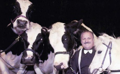 Circus Royale head trainer Robin Howell with his performing cows and pony Lobo.