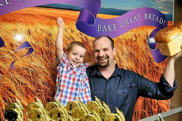 Owner of Born and Bread Bakery Brad Reeves celebrates his store's big win with son Ryan, 2.