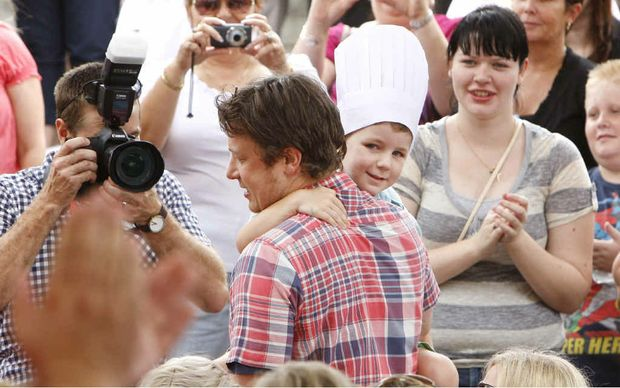 Celebrity chef Jamie Oliver picks Aston Wright from the crowd for his cooking demonstration on Saturday.