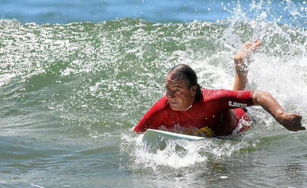 Mick Cottier catching a wave in Friday's North of Fraser section of Reef2Beach Longboard Classic at Agnes Water.