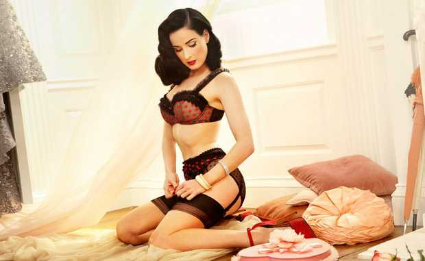 Dita Von Teese models an exquisite item of her lingerie.