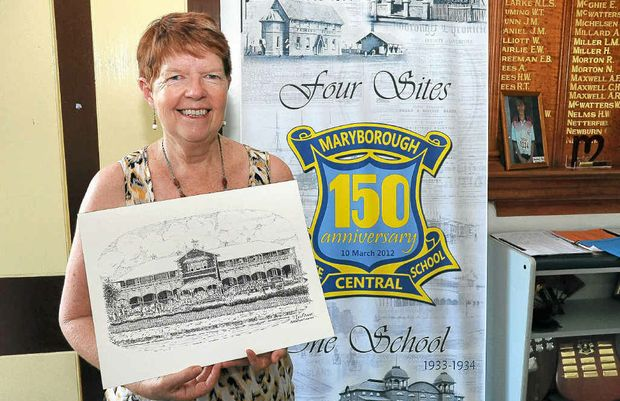 Maryborough Central State School teacher Janet Olds shows off a drawing of the original school building.