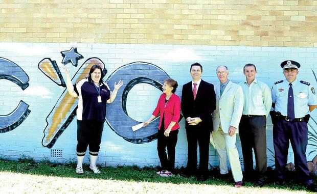 Home Affairs Minister Jason Clare (third from right) with (from left) Lismore PCYC administration officer Sharon Irwin, Page MP Janelle Saffin, Lismore PCYC president John Maxwell, deputy mayor Isaac Smith and Detective Inspector Matt Kehoe.