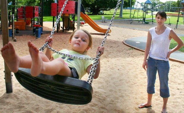 Rebecca Zamit makes the most of some quality time at Victoria Park to play with her daughter Lilly, 3.