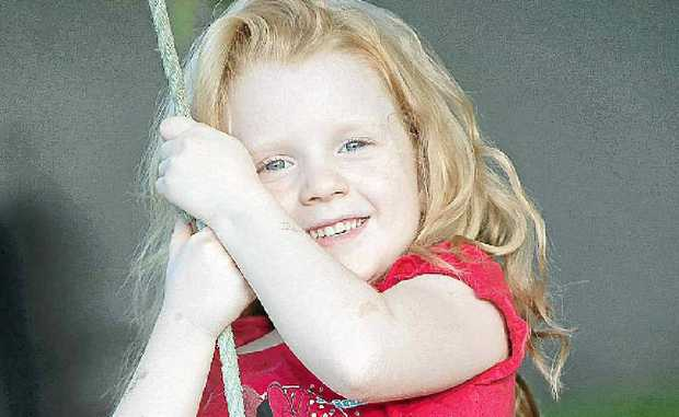 Four-year-old Zoe Young, of Maroochydore, is one child who has no trouble entertaining herself outside.