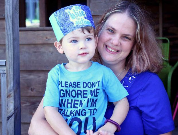 Stacey Collins with her autistic son Jace Collins-McQuaid is raising awareness for autism by dressing in blue.