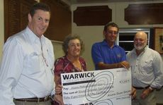 Allora Medical Support Group Chairman Jon Constable is presented with cheques as donations towards the building of a new medical centre in Allora by Allora Show Society President Shirley Cornhill, Allora Sports Club President Kev Harrison and chief organiser of the Allora New Year Mega Party Ted Cowley, at the Allora Cattle Drive Sponsors Auction & New Year Mega Party Funds Presentation at the Allora Sports Club on Friday night.