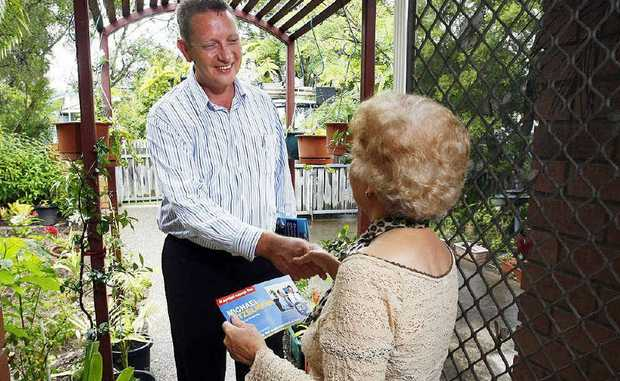 LNP candidate for Bundamba Michael Kitzlemann greets supporter Lilian Morrison on his Dawn to Dusk door-knocking campaign. Kitzlemann has lost 18kg on the campaign trail.