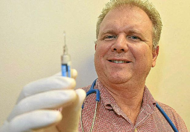Dr Michael Ryan ready to give the flu jab to all comers.