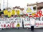 ABOUT 150 people marched down Brisbane St on Saturday to protest against the expansion of a New Chum dump.