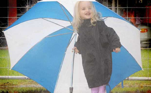 The appropriately named Rayne-Elizabeth Thompson had fun in the rain on Sunday.