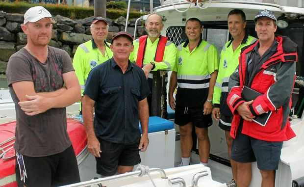 Mick Chappell (left) and his father Dennis Muller arrive at Airlie Beach on board the VMR vessel with crew Tony Bell, Don Martindale, Mick Evans, Tony McNeill and Sgt Graeme Pettigrew.