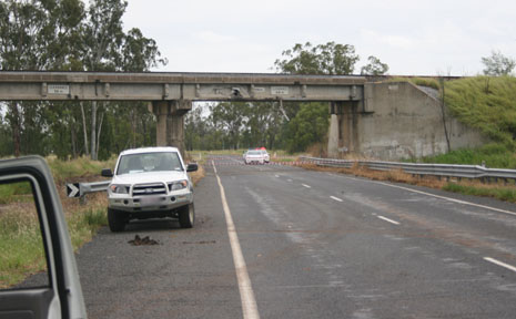 TRUCK-BRIDGE CRASH: The rail overpass on the Burnett Highway has been damaged and the road closed, following an accident with a truck earlier today.
