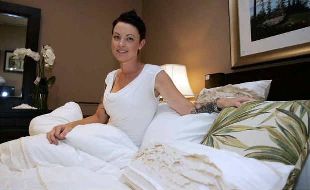 Jennifer McClenahan, resting on one of the beds at Harvey Norman in the Red Hill Homemaker Centre, survives comfortably of six hours sleep a night.
