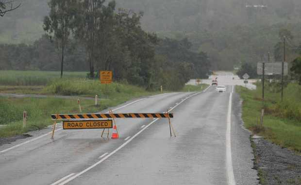 SIGN OF DANGER: The bridge at the Gregory-Cannon Valley turn-off was over flowing on Tuesday blocking residents who lived at Sugarloaf and Strathdickie. Photo Aimee Vinci / Whitsunday Times