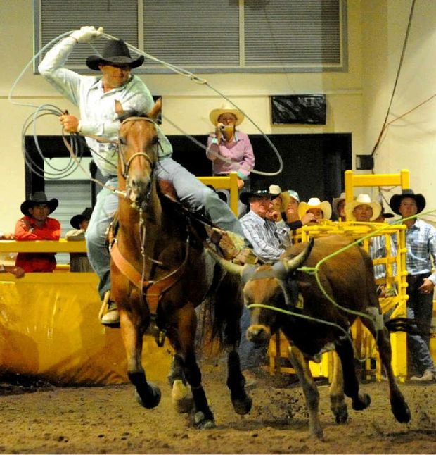 Alton Down cowboy Shane Iker, seen here team roping at the National Finals on the Gold Coast, is one of those hoping to compete this weekend in Comet should the road conditions allow.