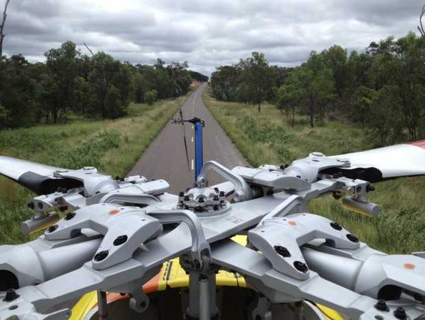 RACQ-CQ Rescue's helicopter landed on a road near this morning's crash scene.