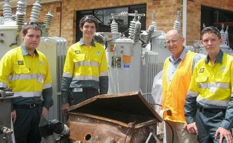 Work experience recruits (from left) Sam Richards, Duncan Nish and Steven Thompson are shown around the Ergon Energy Maryborough depot site by area services manager John Box (second from right).
