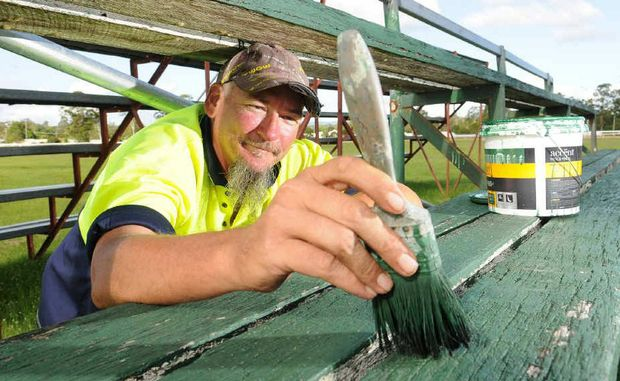 Show volunteer James McCullough makes his donation in the most practical way, with hard work.